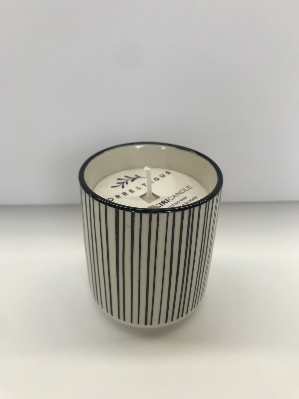 "Black Line Votive Candle (Unscented) - Colour:  Black + WhiteDimensions:  2.5"" Diameter x 3"" HPrice:  $10.00 + HSTSale Price:  $7.00 + HST"