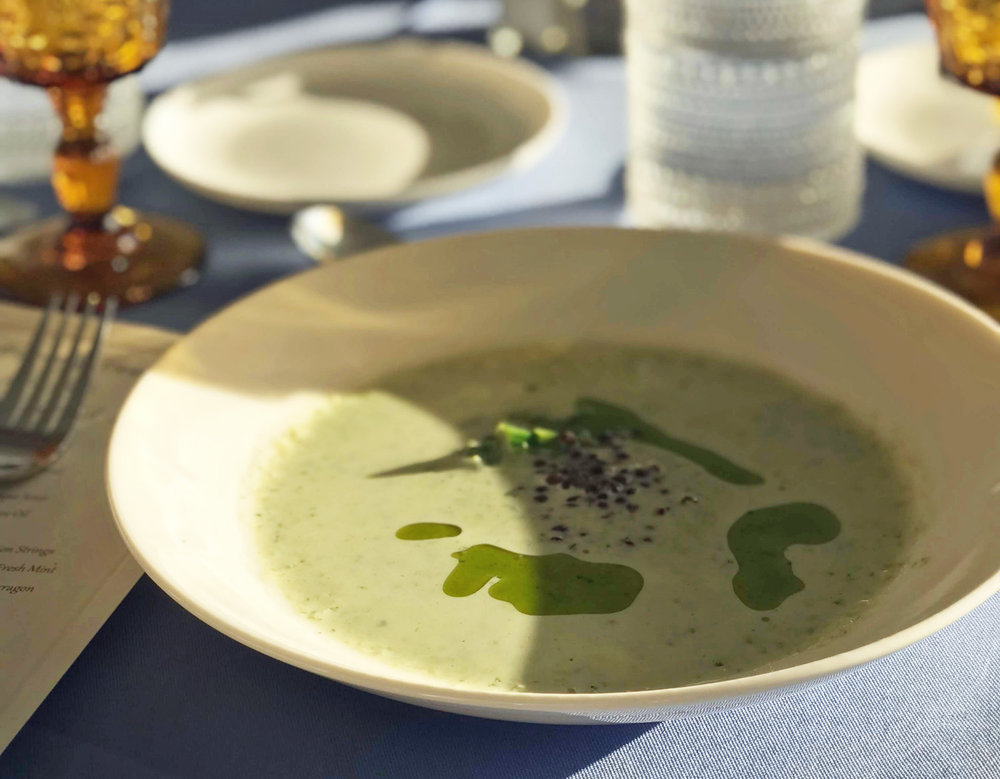 Spring ramp and asparagus soup with beluga lentils and chive oil