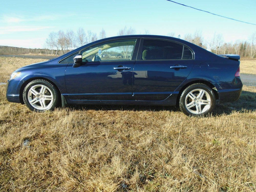 automotive-repair-project-car-blue-acura-side.jpg