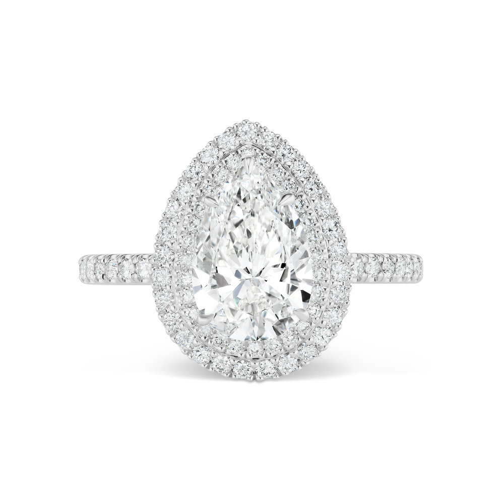 Pear-shaped diamond ring with micropavé diamond trim and band, mounted in platinum. .jpg