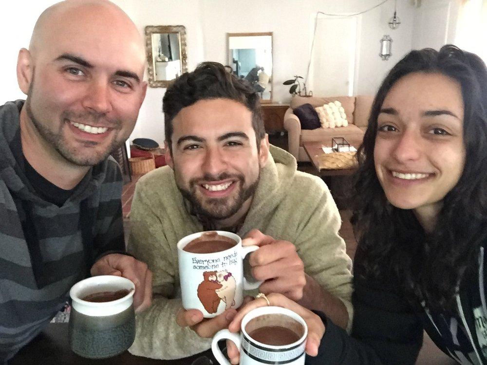 Soul Lift Cacao founder Nick Meador (left) enjoys ceremonial cacao with friends