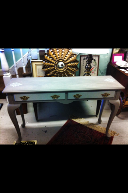 The lovely console table in shades of gray.