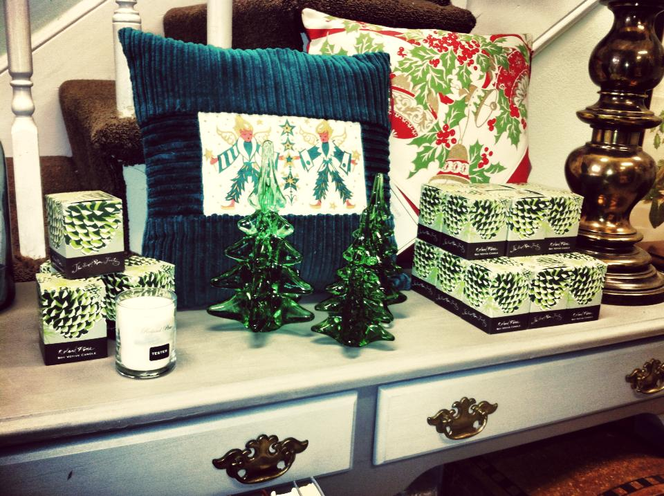 roland pine holiday candle and pillows