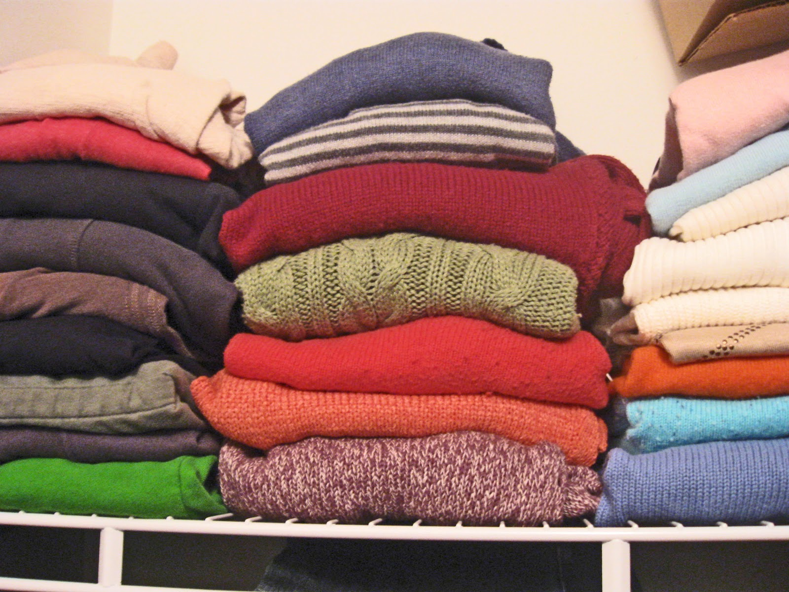 folded stacked sweaters