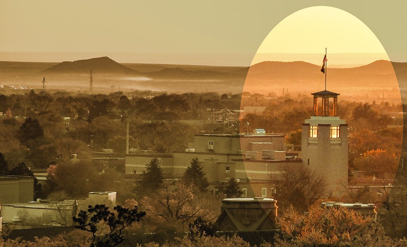 Photograph of downtown Santa Fe by Jim Hawkins (2016) from Fort Marcy Park. The 105-foot tower known as the Bataan Memorial is part of the 1950 renovation of the state capitol building of New Mexico.