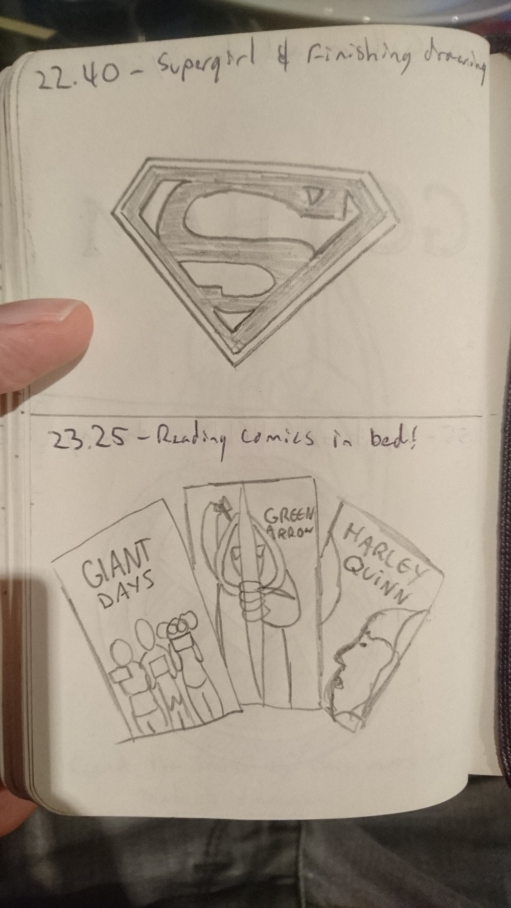 22:40:  Supergirl and finishing drawing.  23:25: Reading comics in bed!