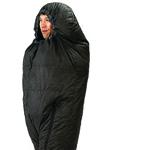 man walking in a sleeping bag