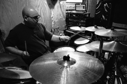 Photo of Mark Monette playing drums by Ashley Owen