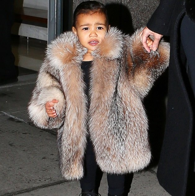 Kim Kardashian walks North West out of their apartment in NYC