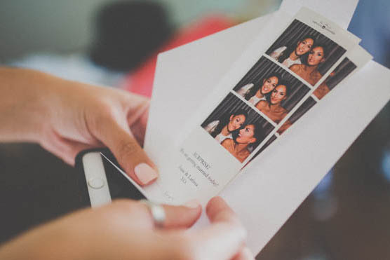 Photo booth pictures in hand at a kapiti wedding
