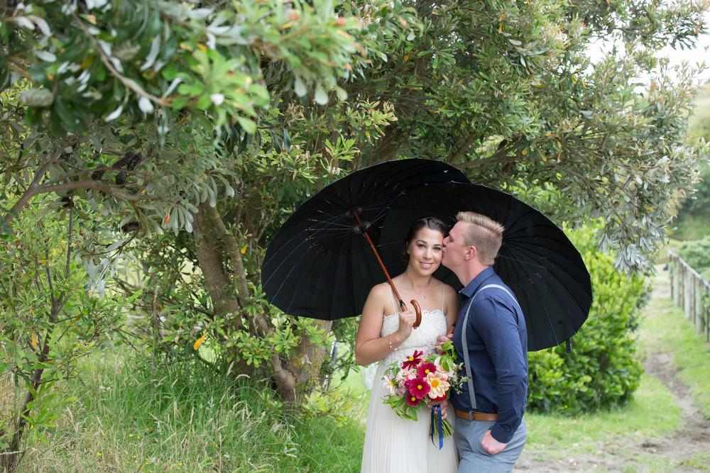 Rainy wedding photos on the Kapiti coast, Wellington. Photo by Jo Moore.