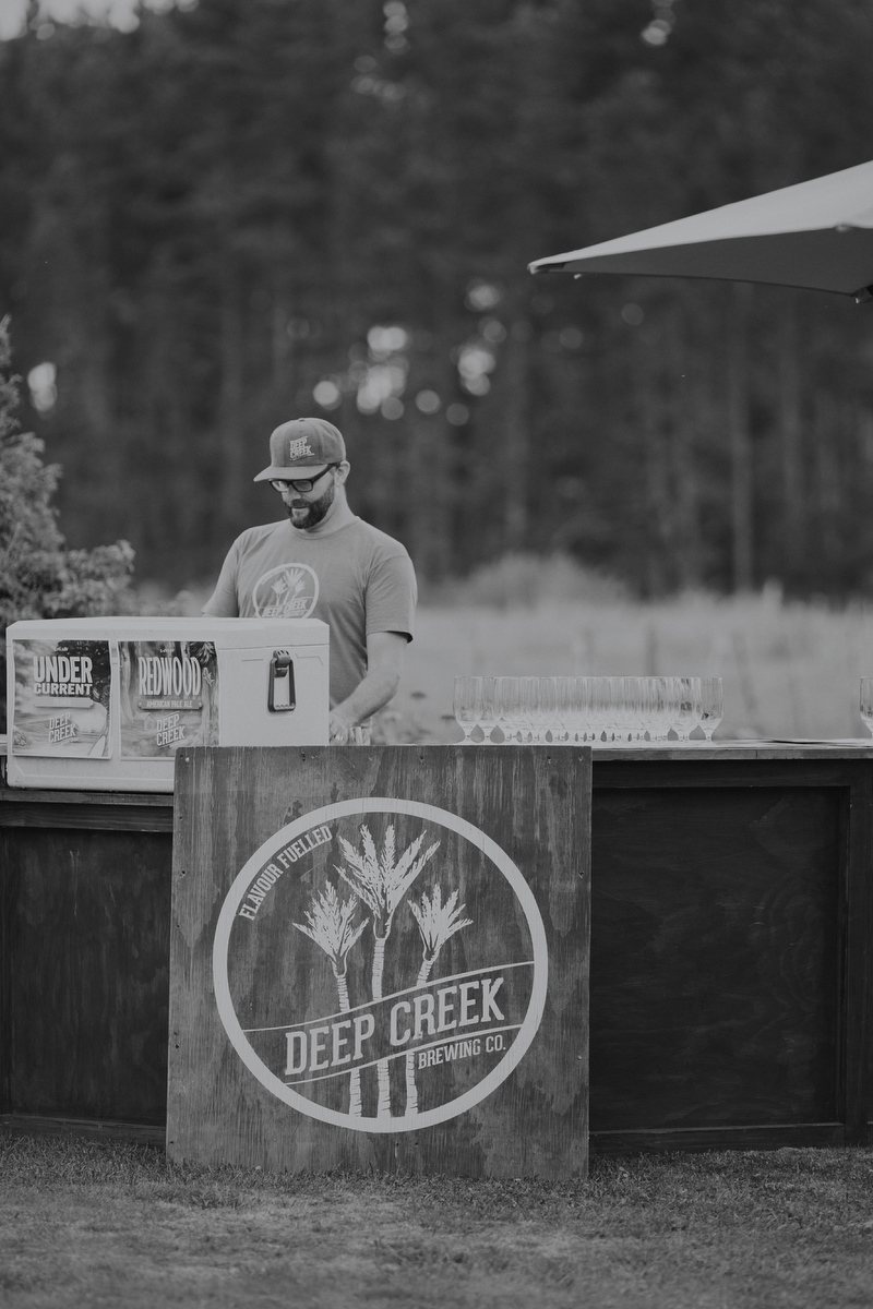 Black and white craft beer drink station at wedding