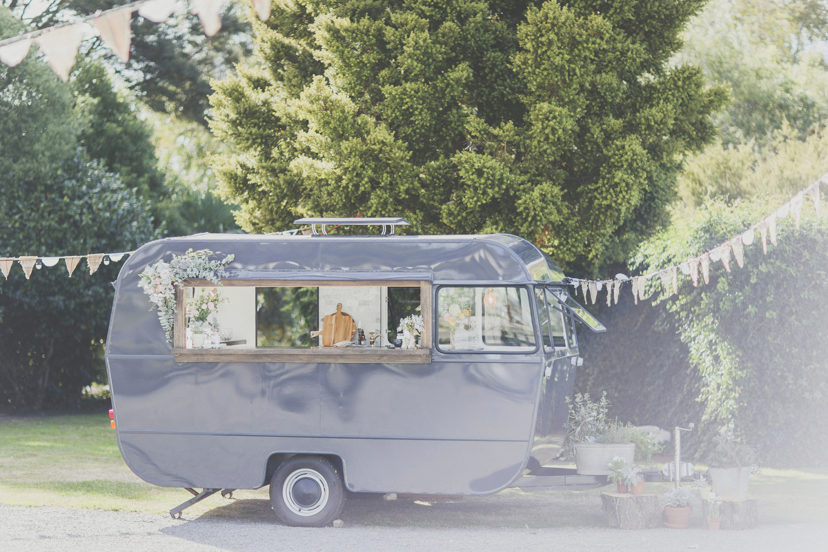 Caravan bar sitting pretty in the glow of the sunshine at a Neww Zealand Wedding.