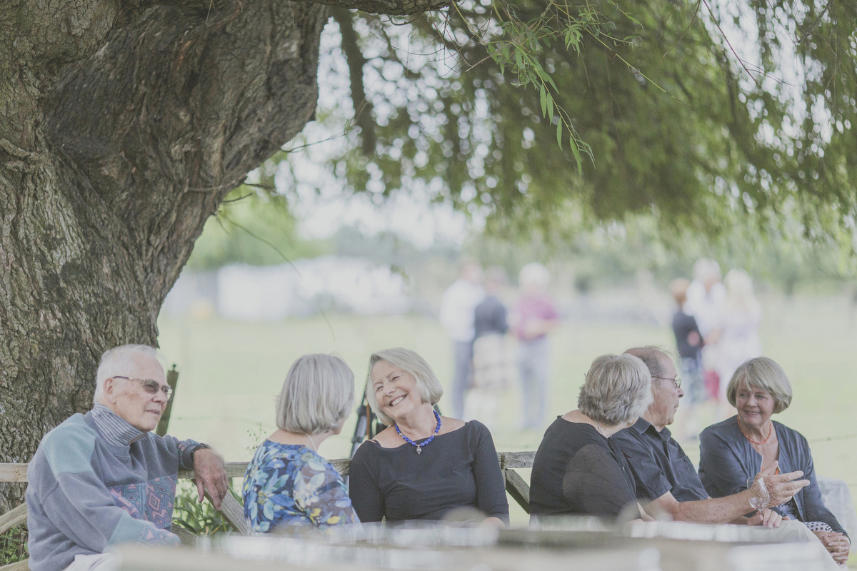 Guests enjoy outdoor seating at wedding in new zealand