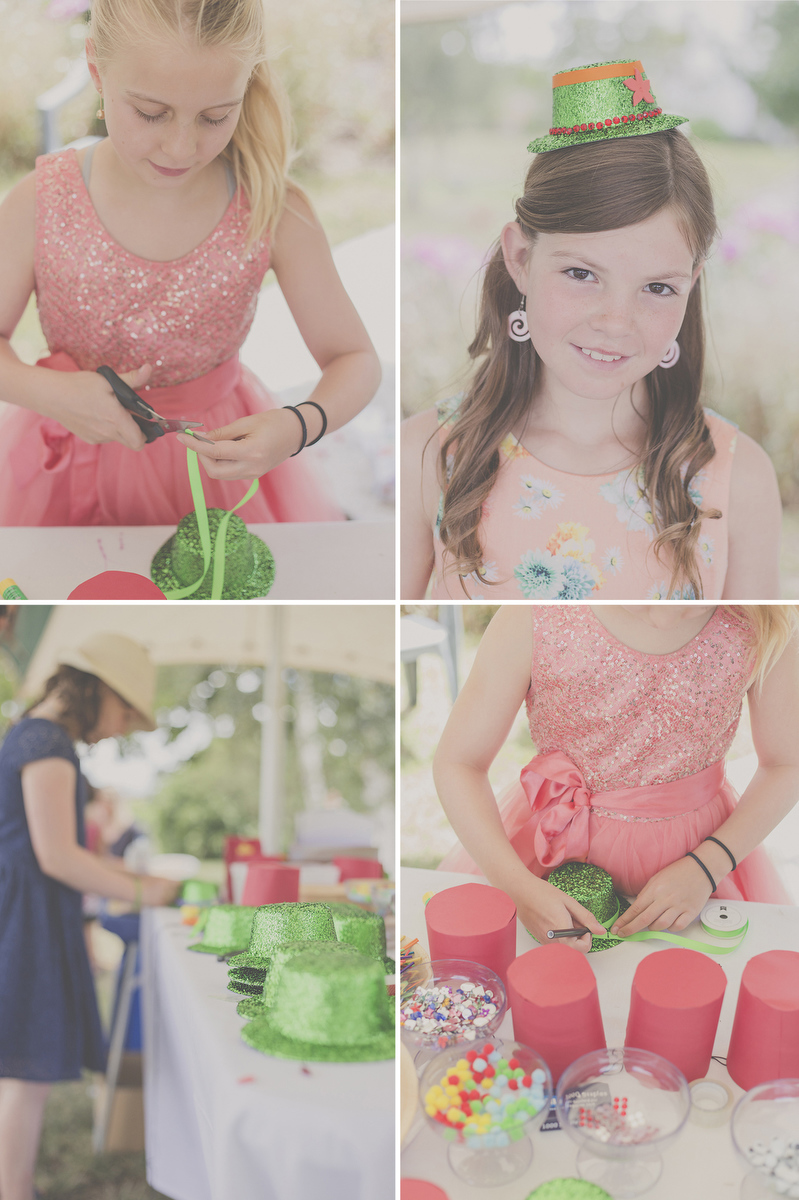 Kids having fun at a wedding with a craft station.