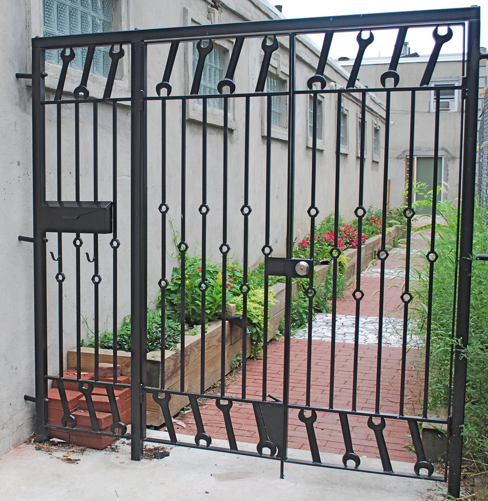 GATE WITH WRENCHES - private artist studios, Pentridge St. Philadelphia, PA