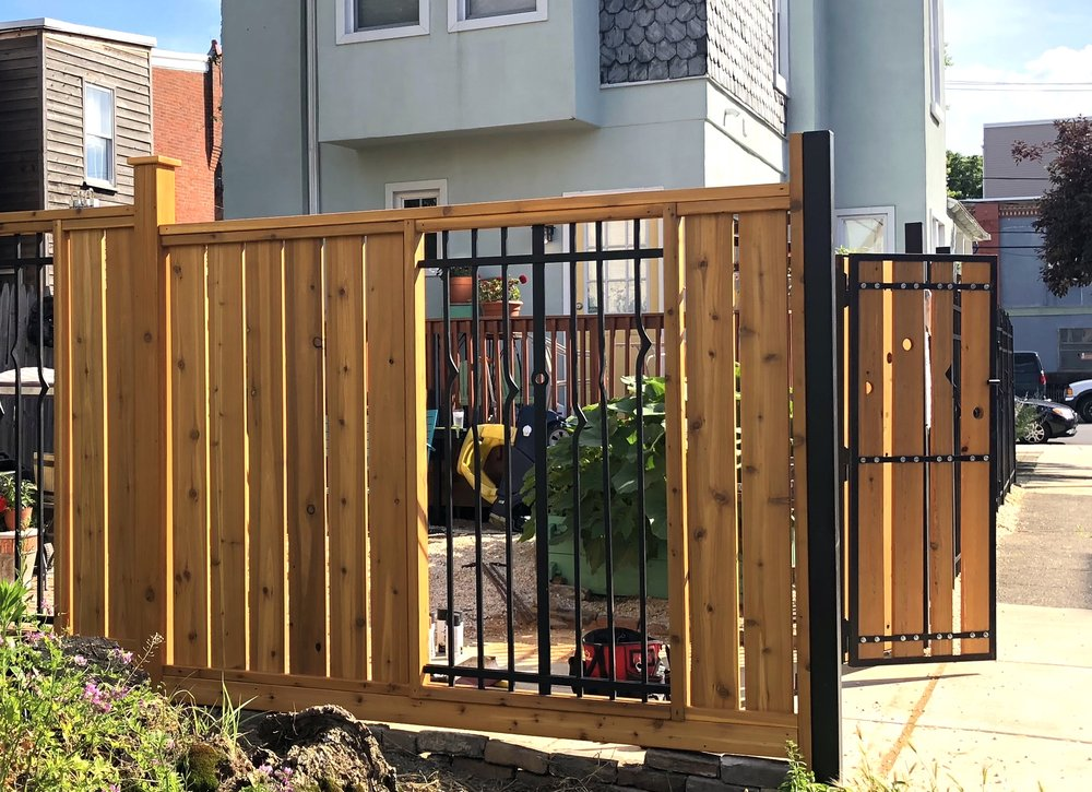 FORGED IRON FENCE WITH CEDAR DRIVEWAY GATE - private residence, Pentridge St., Philadelphia PA