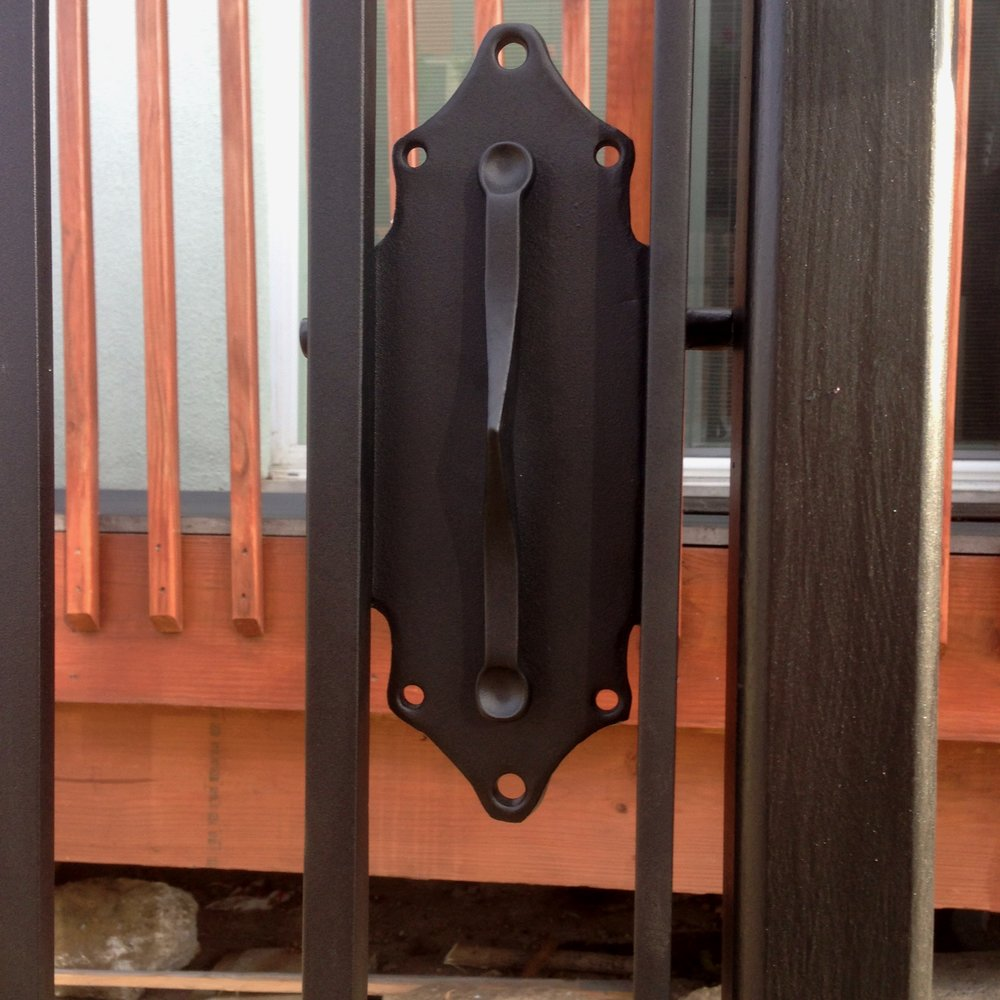 FORGED IRON FENCE (detail of lock plate)