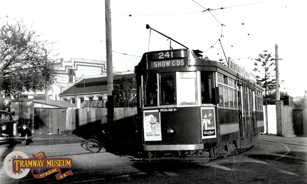 F type 'Drop Centre' tram 241 leaving the Wayville Showgrounds on another trip back to the City to collect another load of passengers bound for the showgrounds. The former Centennial Hall can be seen in the background to the left. Today, the present Jubilee Pavillion and Ferris Wheel would dominate the background of this scene.