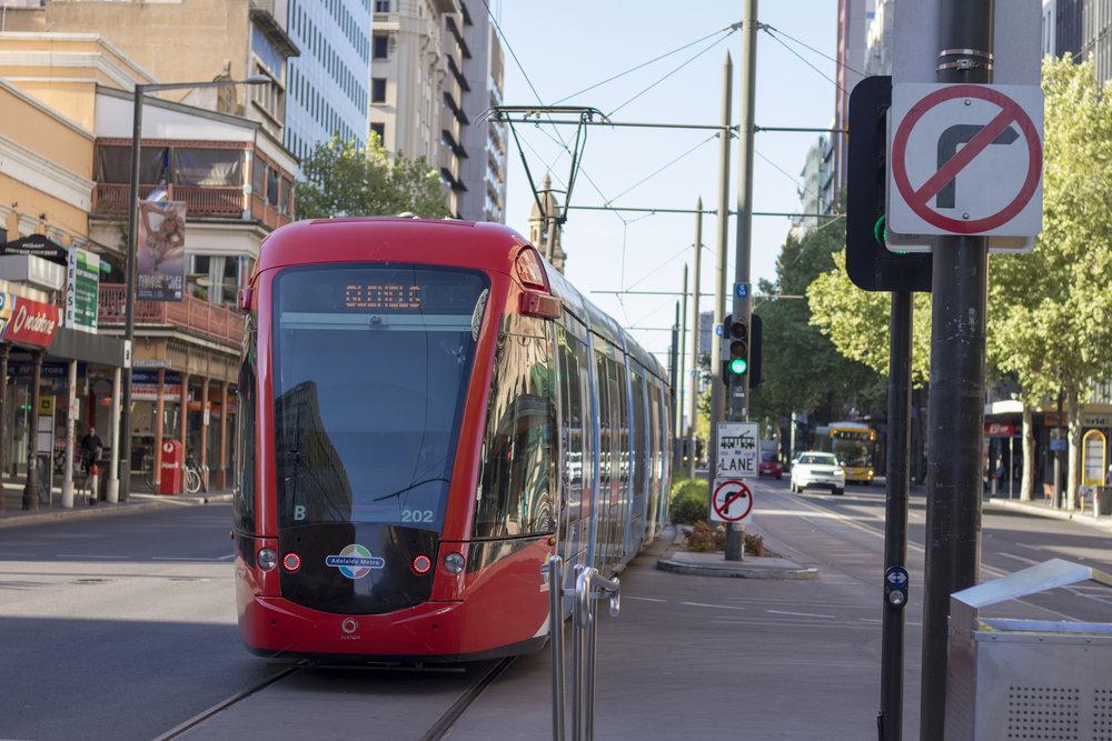 Alstom citadis 302 tram no. 202 departs rundle mall tram stop towards glenelg.