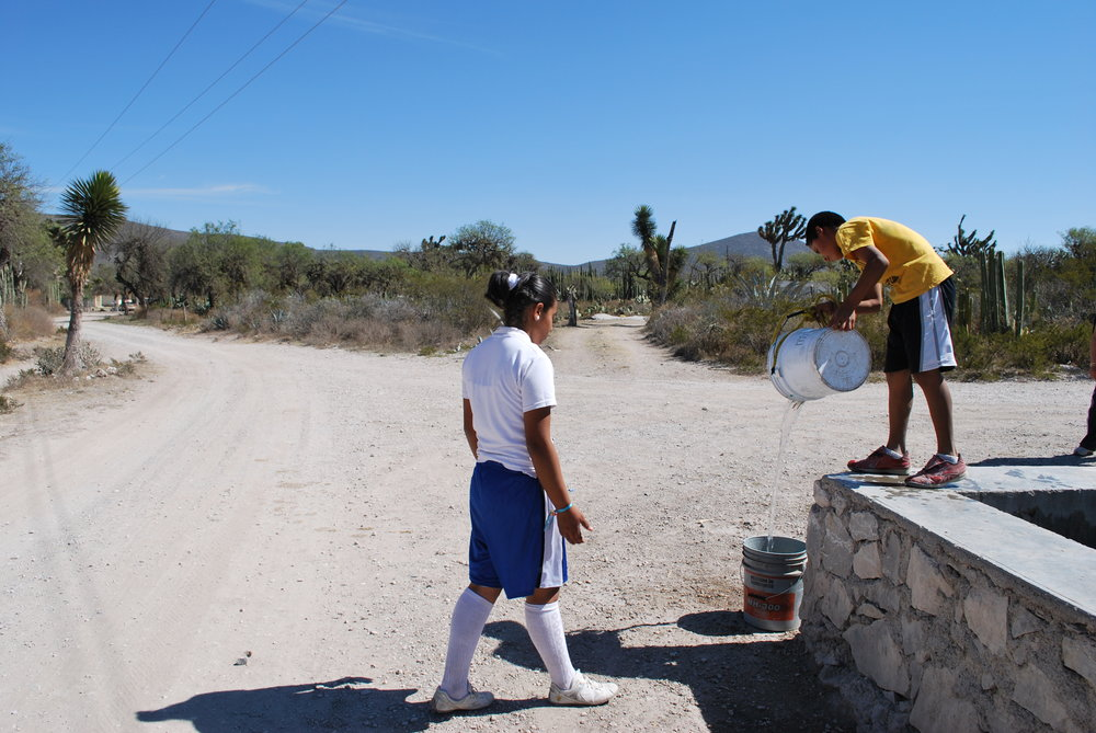 Students collect water for school