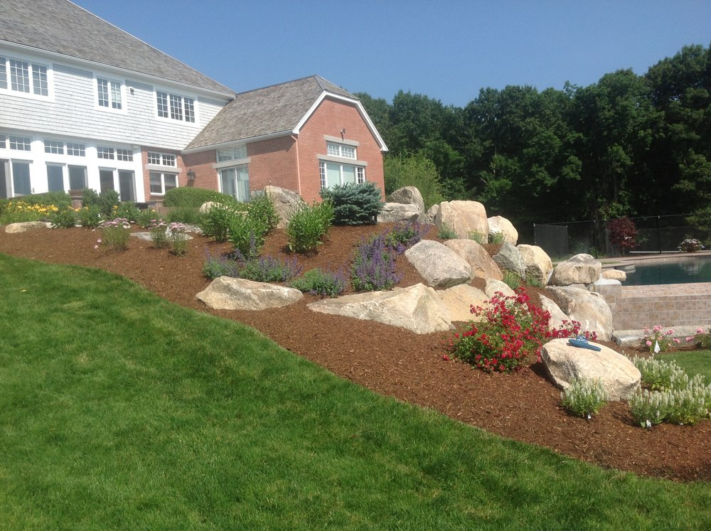 Lawn mowing, fertilizing, spring and fall clean up, mulching, edging, plantings
