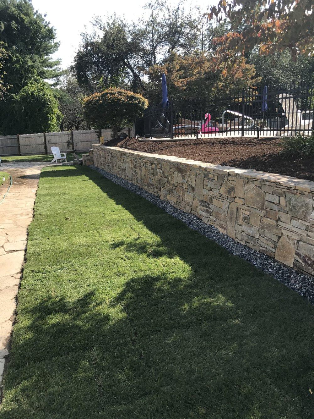 Stone wall, edging, lawn maintenance, landscaping