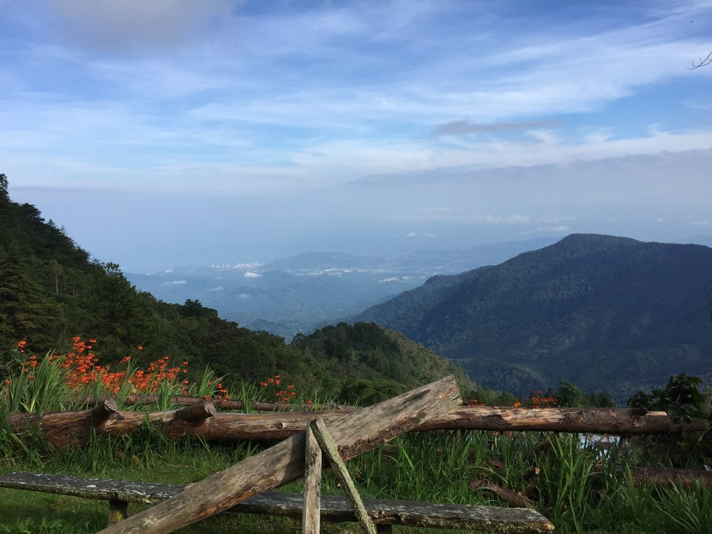 CERRO KENNEDY, COLOMBIA – JULY 28TH, 2017: The view from 8000 feet above sea level, just outside the gate to the San Lorenzo weather monitoring station. The city of Santa Marta sits in the distance where I arrived by plane three days prior.