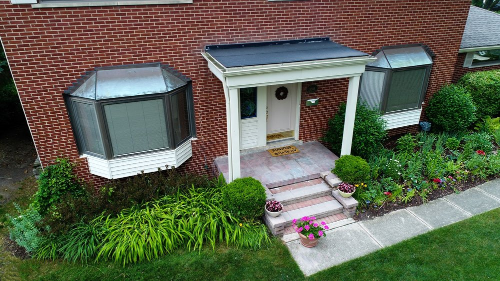 Landscape design with patio pavers in Shelby Township, MI