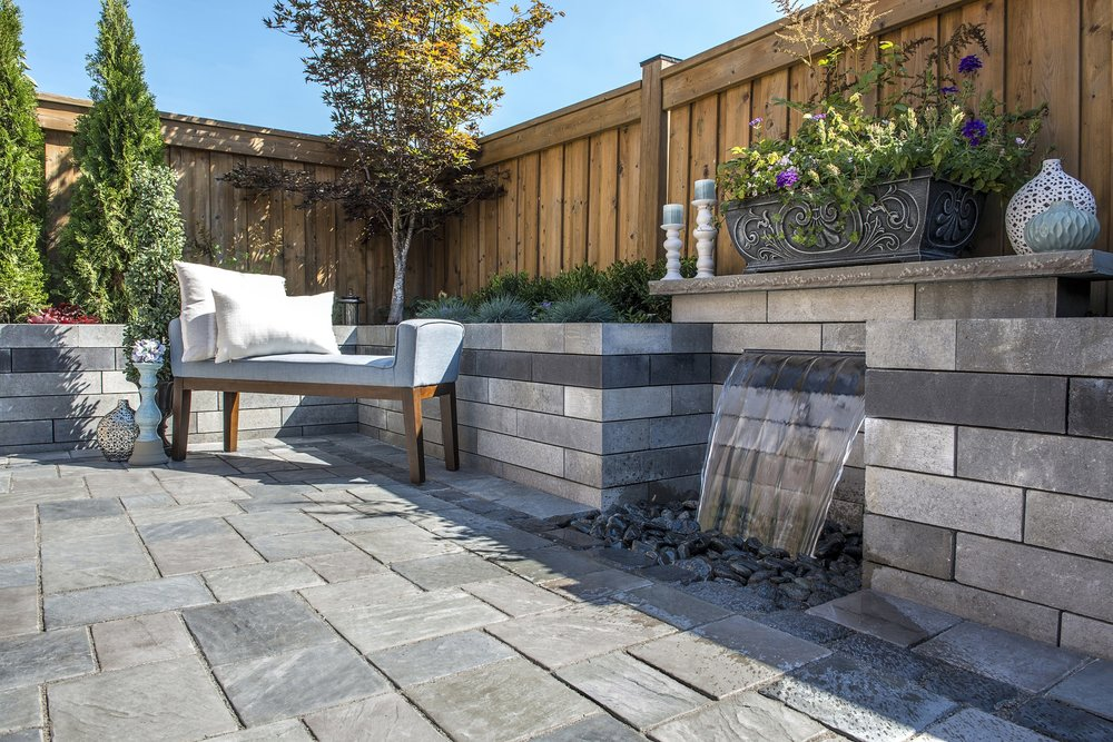 Unilock landscaping companies in Troy, MI for outdoor fireplace