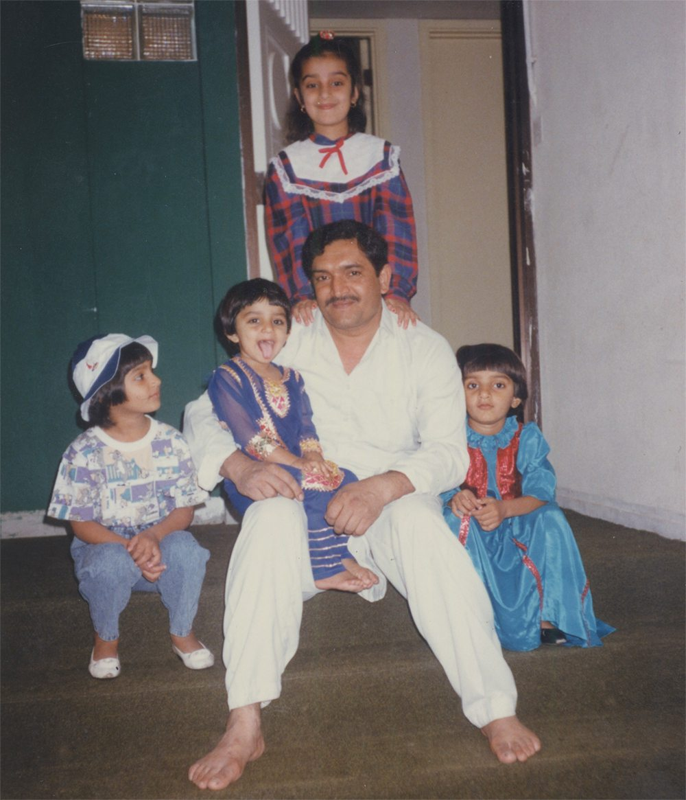The author, top centre, at age seven, shown with her father and three younger sisters at their home in the United Arab Emirates