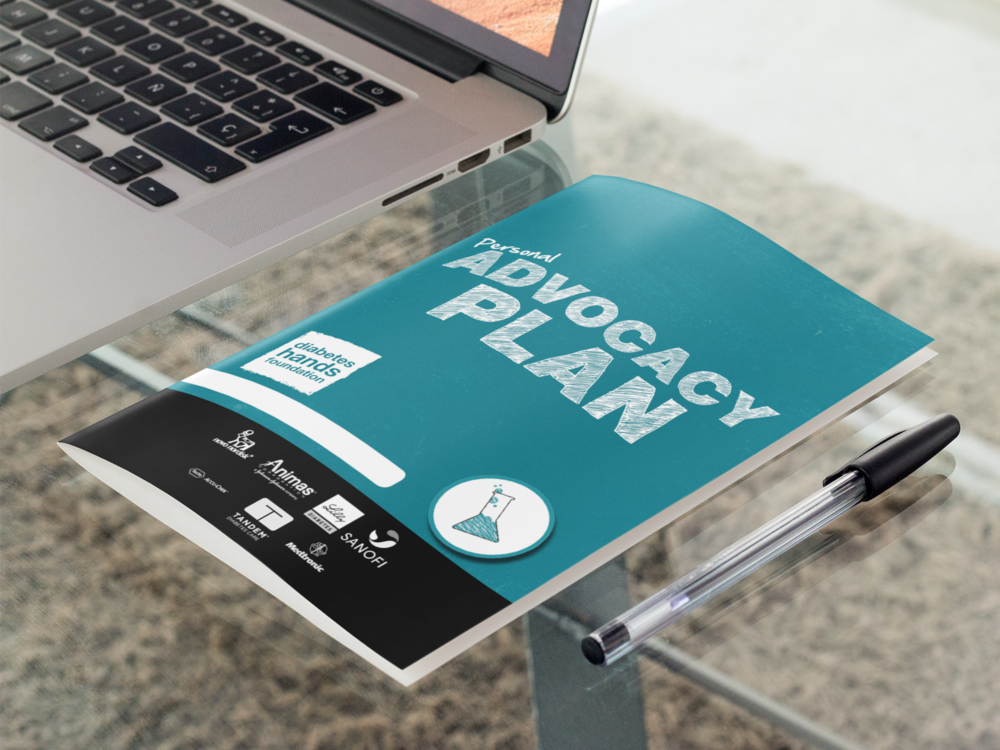 bifold-brochure-mockup-lying-next-to-a-laptop-in-an-office-a10308.png