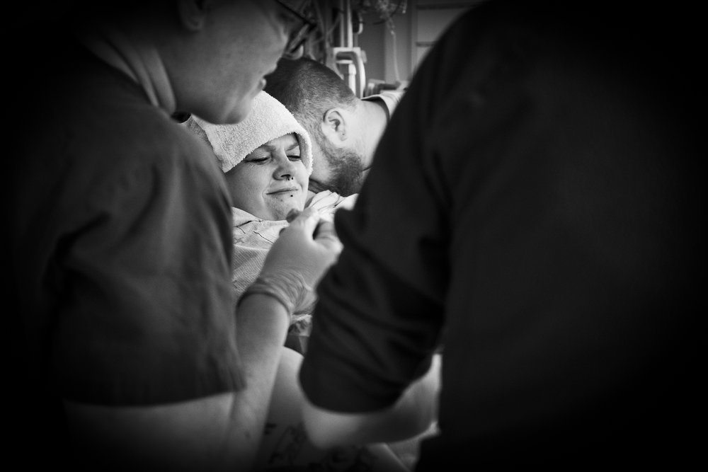 Cory whispers strength into Torey's ear while she pushes during each contraction. And the health care team (Barrie Midwives) gives Torey amazing support during her labour and delivery.