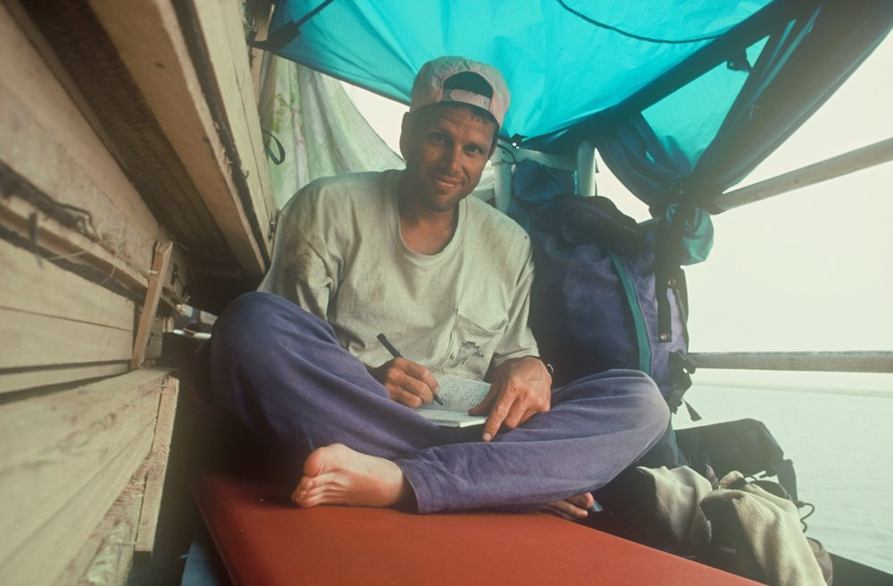 Me writing during a journey down the Niger to Timbuktu.