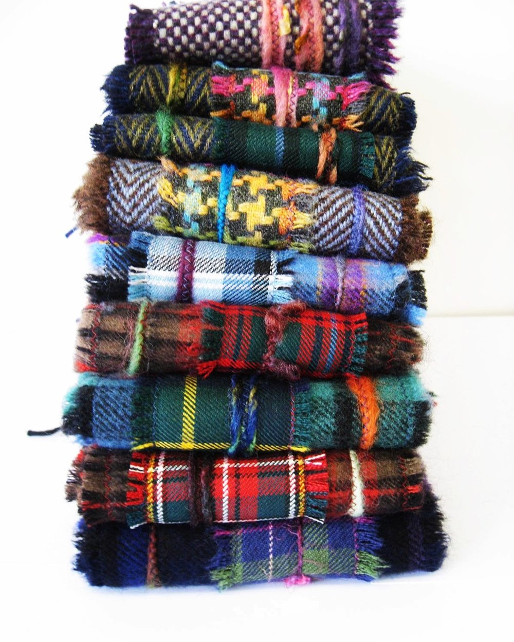 Fringe Scarves - Fringe Scarves are made from my softest wool tweeds and lightweight tartans all locally sourced. They are made with a couple of layers of fabric and added funky yarns and fringing for extra texture and colour. They make great gifts as everyone loves a warm scarf.
