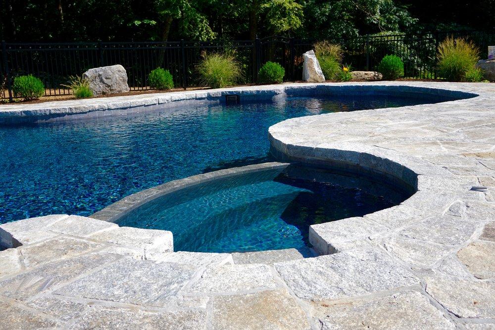 In-ground free form custom gunite spa and swimming pool