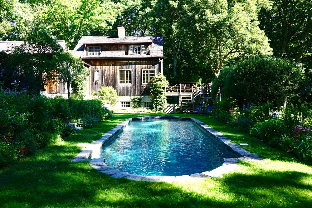 A rectangular swimming pool with curved ends achieves a more natural look.