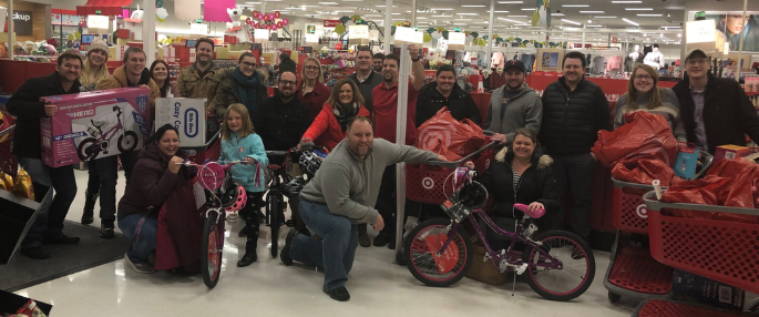 Alumni with over $2,000 worth of toys purchased at the annual TCAC Toys for Tots event.