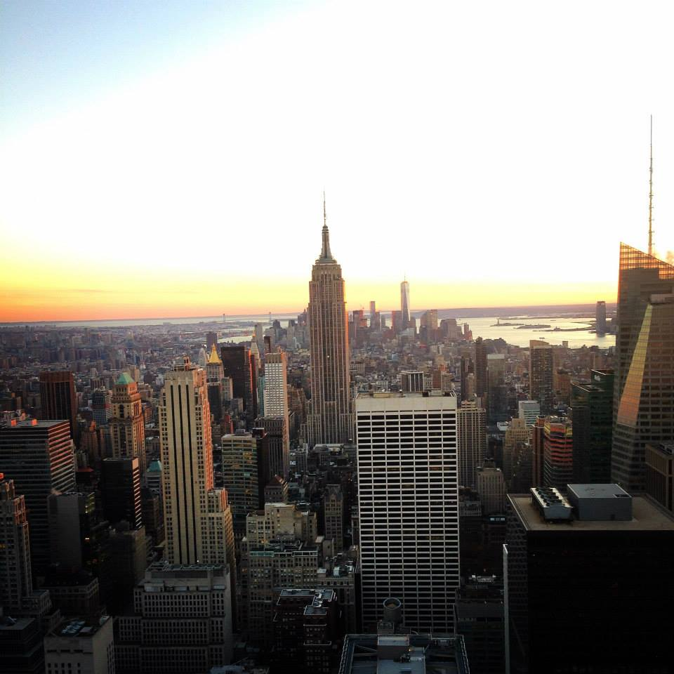 the empire state building at sunset from top of the rock