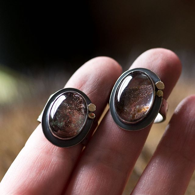 Two lodolite rings available in the shop now. Size 6.5 and size 8. 14k gold accents and oxidized sterling with open backplates to let the light shine through. 👌 #buffalolucy #handmadejewelry #silversmith #metalsmith #riojeweler #lodolite #phantomquartz #uniquejewelry #ooakjewelry #opthandmade #beautiful #picoftheday #cocktailring #handmaderings