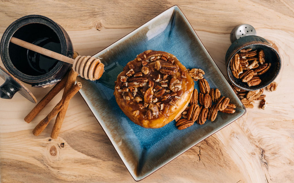 Caramel Pecan Sticky Bun - Toasted pecans and honey caramel cover our tender sourdough pastry with sticky goodness.
