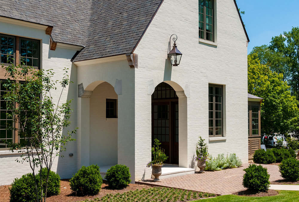 nash_circle_crestline_mountain_brook_alabama_new_residence_02_front_entry_porch_elevation_gable_painted_brick_1500.jpg