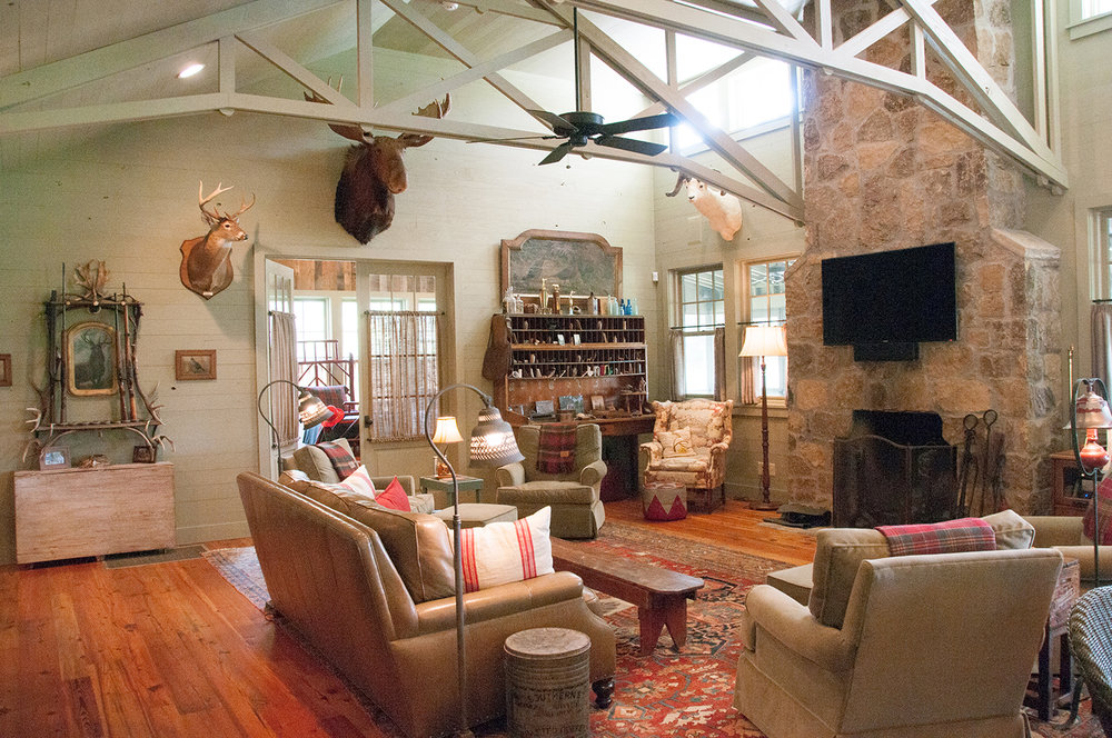 sugar_creek_farm_19_lakehouse_lake_house_den_sitting_room_fireplace_chimney_stone_farmhouse_truss_vaulted_ceilingf_1500.jpg