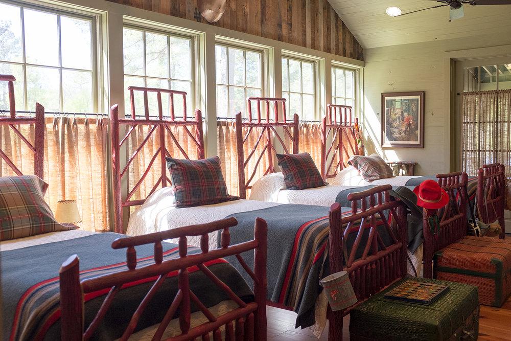 sugar_creek_farm_31_lakehouse_lake_house_sleeping_porch_farmhouse_beds_wall_paneling_1500.jpg