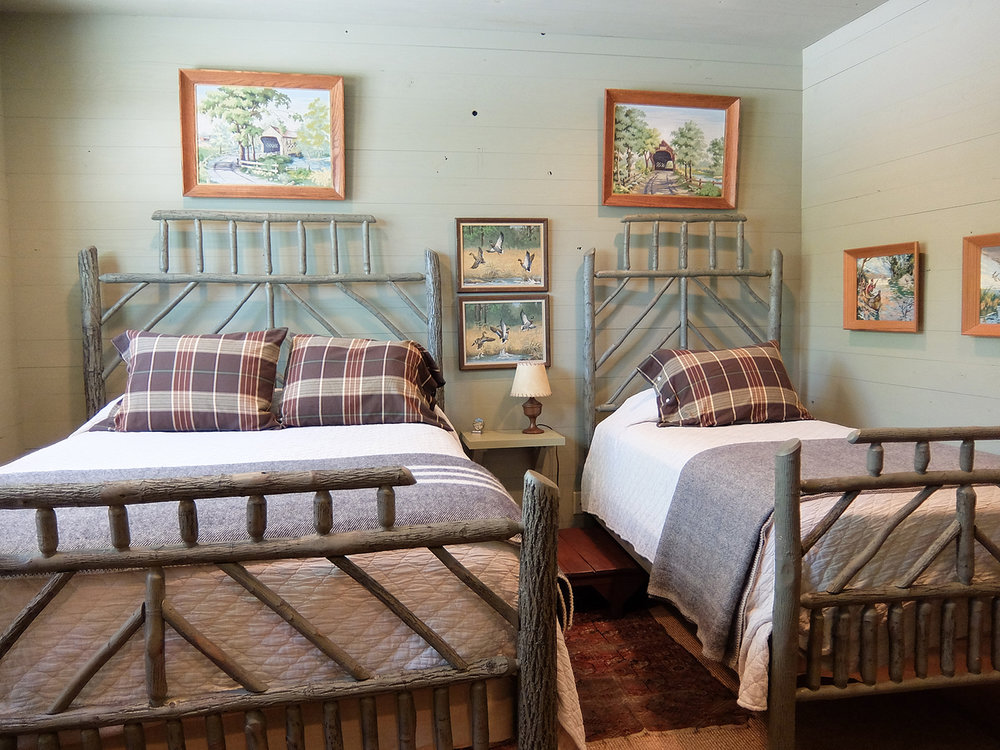 sugar_creek_farm_37_lakehouse_lake_house_guest_room_beds_farmhouse_1500.jpg
