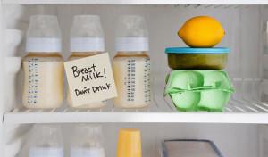Bottles of breast milk in refrigerator --- Image by © Image Source/Corbis