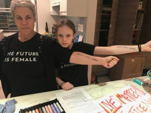 The author and her daughter preapring for the Women's March in part ot honor her grandmother's legacy of leadership.