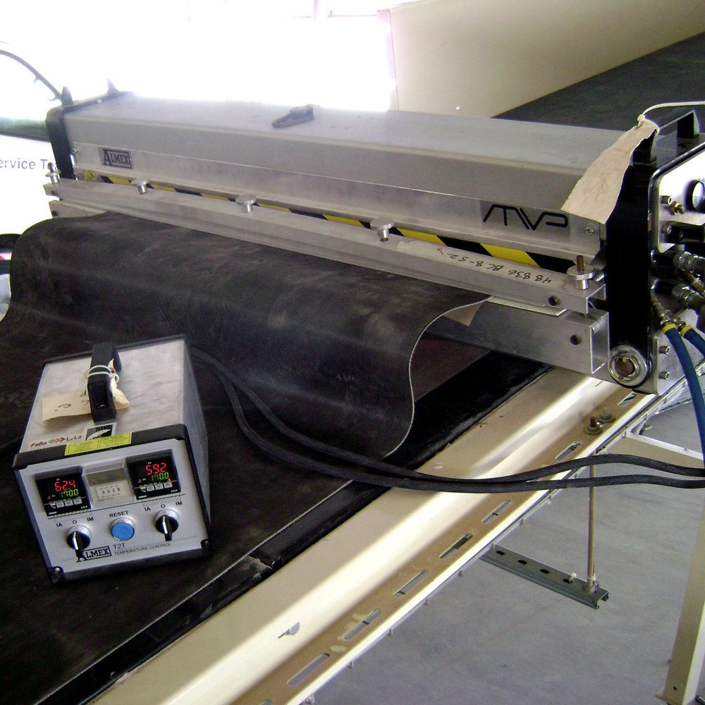 """Belt Vulcanization - Heat vulcanization services are available in-house or on-site for your conveyor application. Lufkin Rubber & Gasket can vulcanize belt up to 84"""" wide!"""