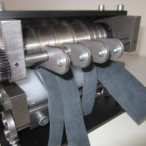 """Belt Slitting - We can custom slit your belt to the width of your specification! Our slitter has an 84"""" width & 30,000lb capacity… so we can handle your belt!"""