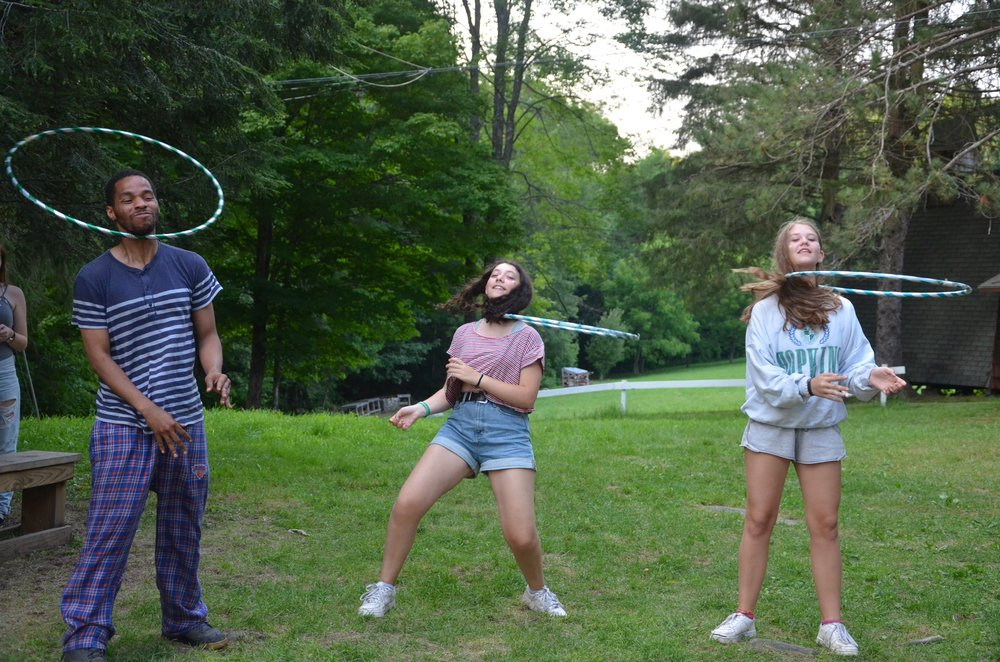 Playing with hoola hoops